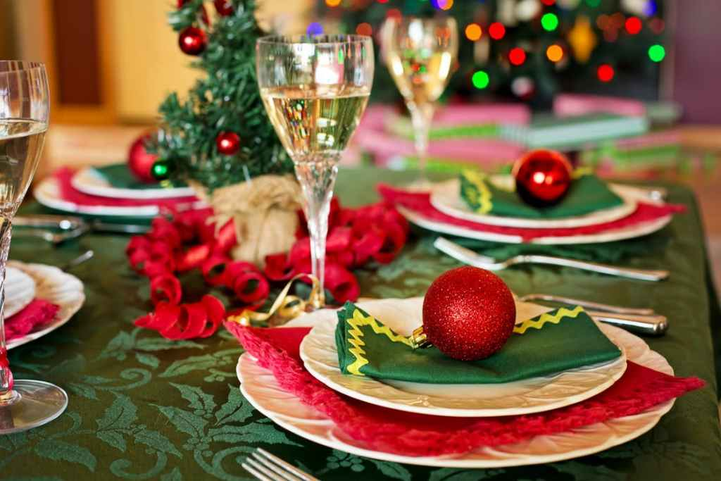 Wine glass on a table decorated with christmas items