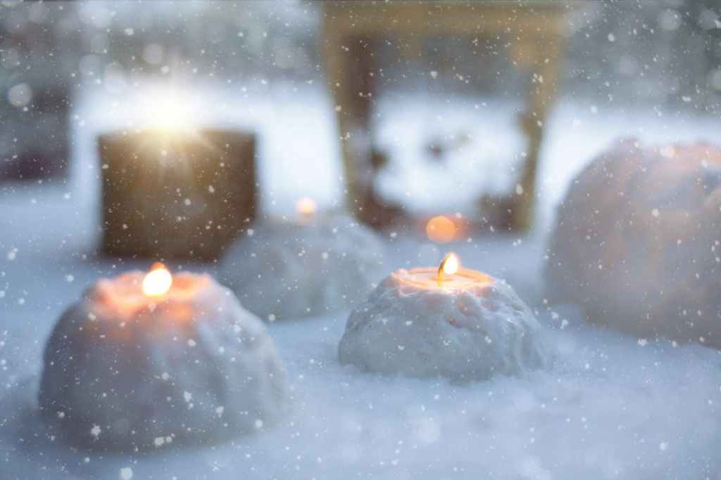 Candles lit in the snow