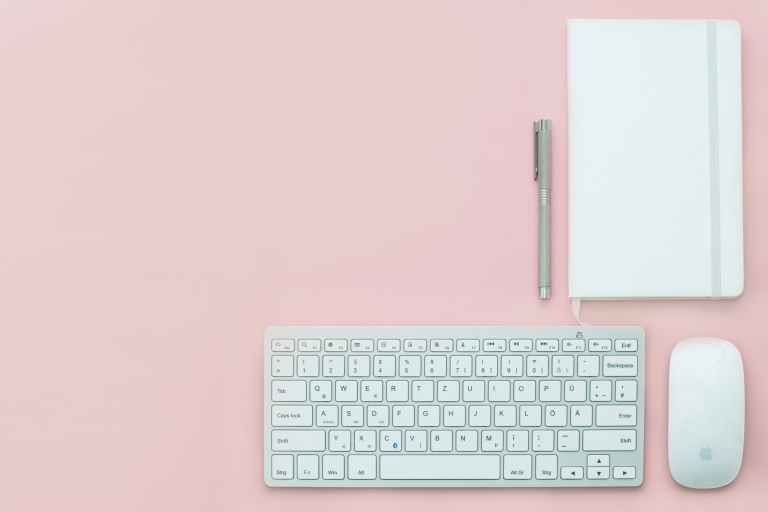 Pink desk with white keyboard