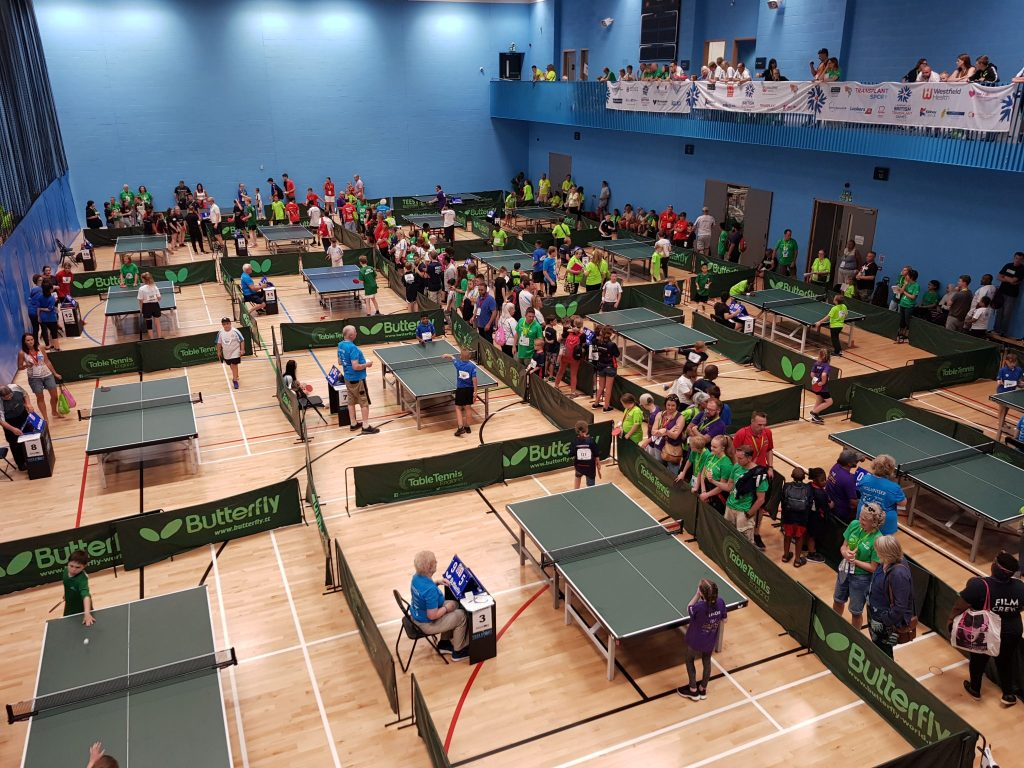Many people playing table tennis