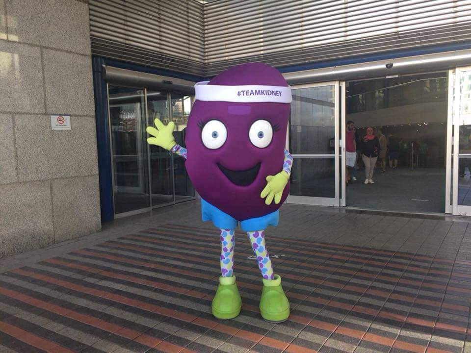 Kidney mascott waving