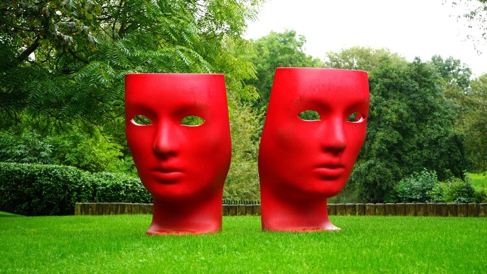 Sculptures of masks in a park