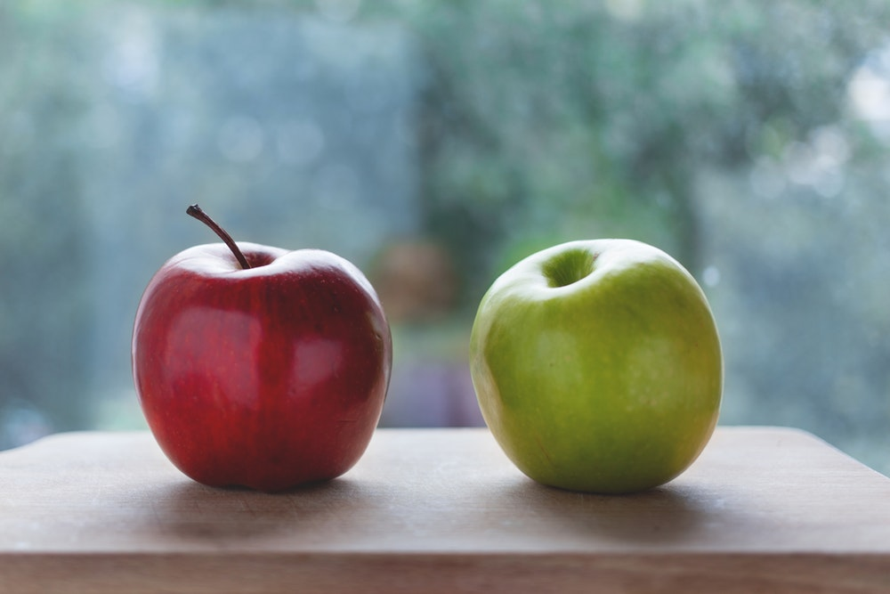 A red and a green apple