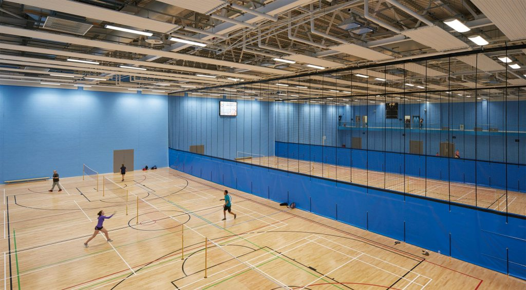 People playing badminton in the Munrow Sports Arena