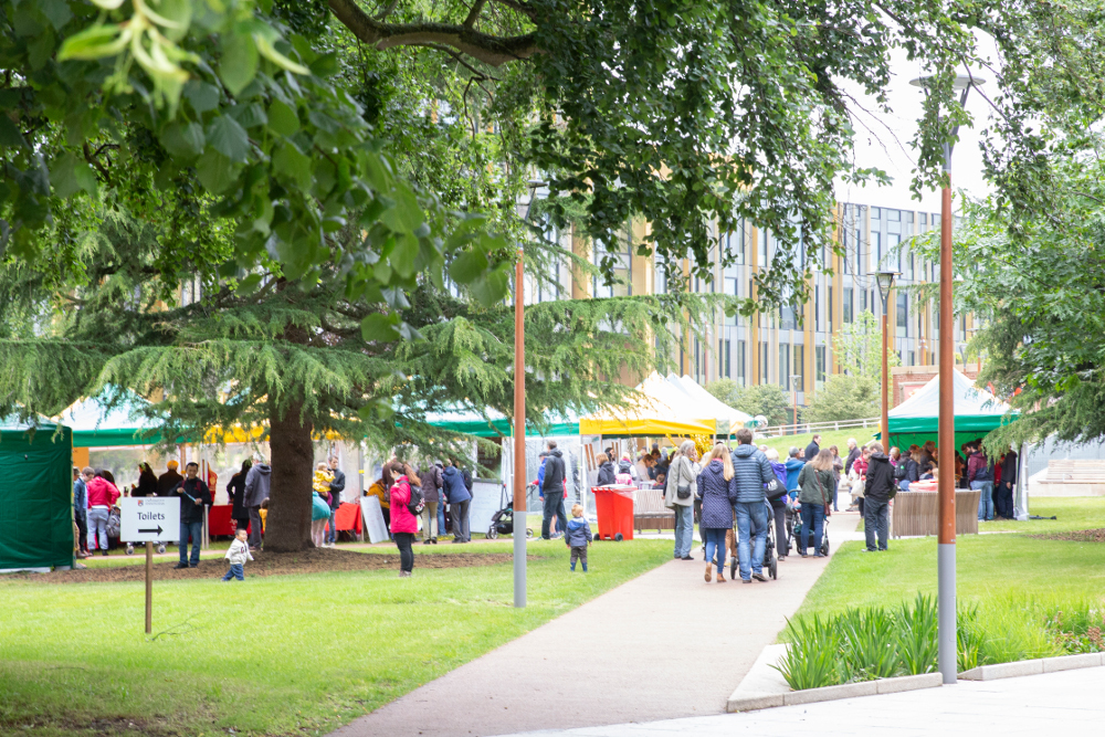 Busy stalls with street food and activities