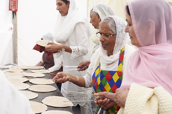 Sikh women making chapattis