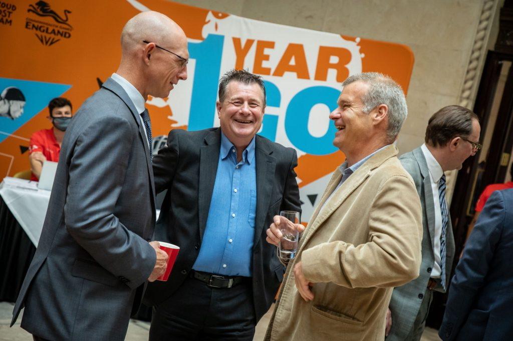 3 people laughing at 1 Year to Go Stakeholder Reception