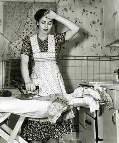 50s woman ironing