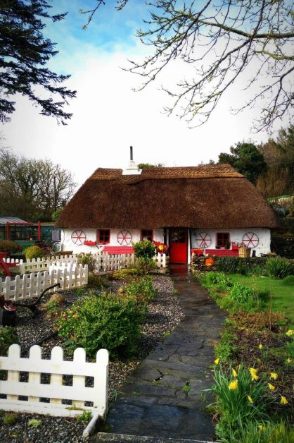 and old english cottage with thatched roof