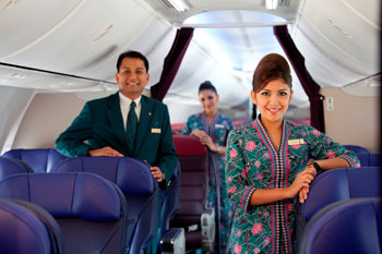 Male flight attendants wear grey jackets and the female crews Batik uniforms are very similar to the Singapore Airlines girls Sarong outfit.