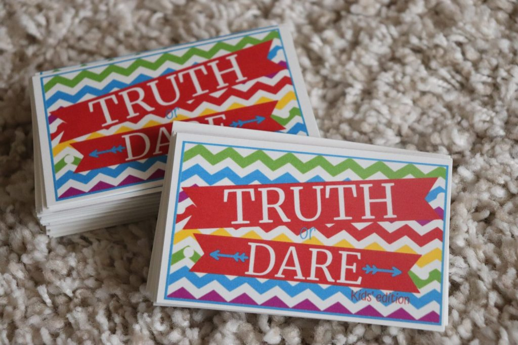 Are you looking for some super awesome truth or dare questions for kids? Well, we have tons of clean truth or dare questions for kids that are perfect for families too!