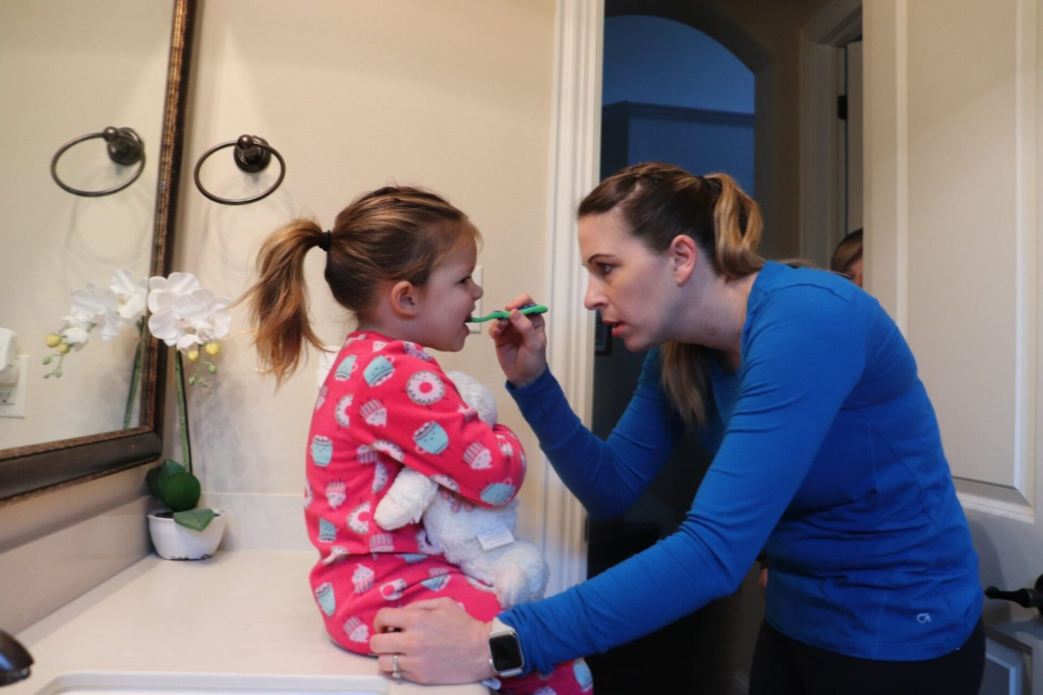Do you have a toddler brushing teeth struggle every single day like I do with mine? We have the simple tips you need to help make toddler tooth brushing fun!