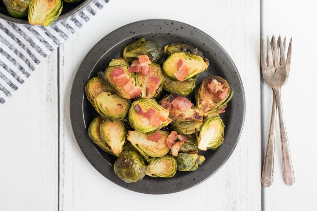 Roasted Brussel Sprouts with bacon are the most delightful vegetables you can feed your tastebuds. Crispy Brussel Sprouts with bacon will be a family favorite in no time!