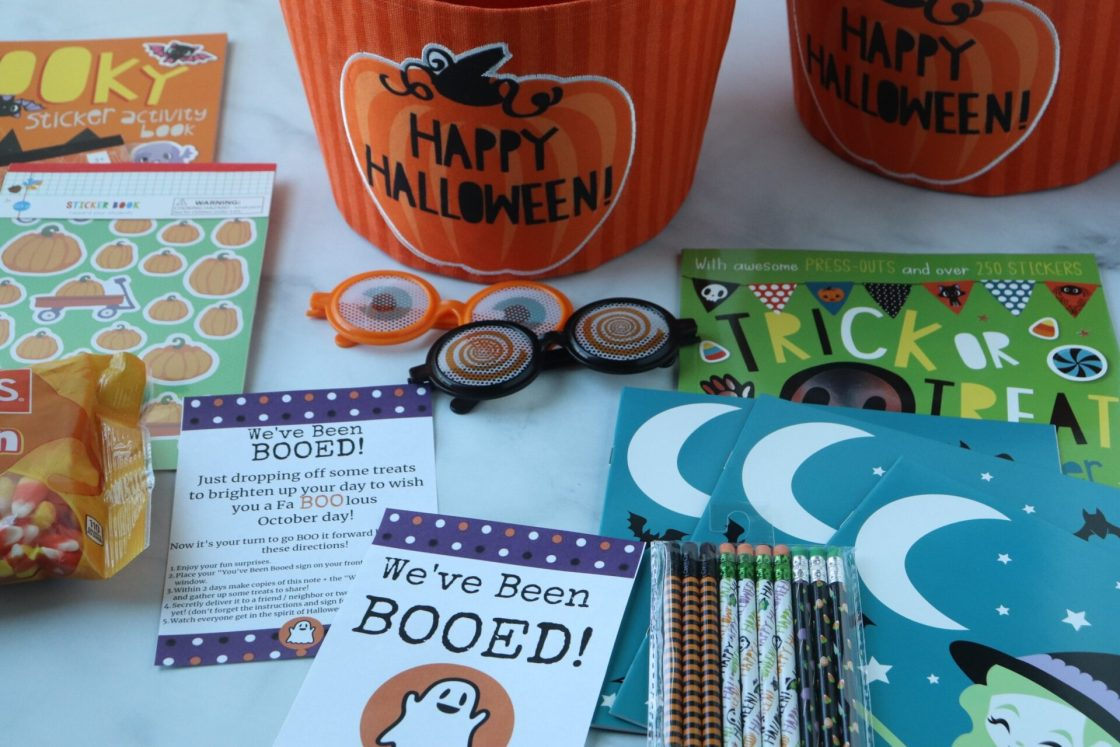 """Grab some treats and put on your running shoes as you and your family share the magic of Halloween as you go around dropping """"You've been booed"""" surprises!"""