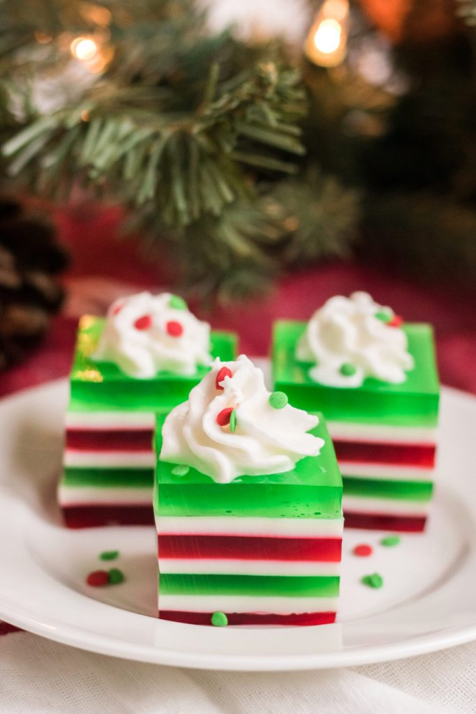This Christmas finger jello is perfectly tasty and festive for your next holiday gathering. Kids and adults all love eating layered jello with their fingers!