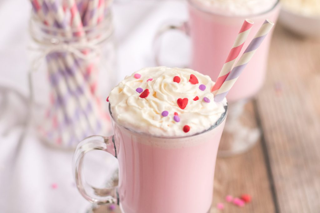 This quick and easy Valentine's Day Hot Chocolate is a family favorite. Just a few simple ingredients make this white hot chocolate perfectly delicious for Valentine's Day!