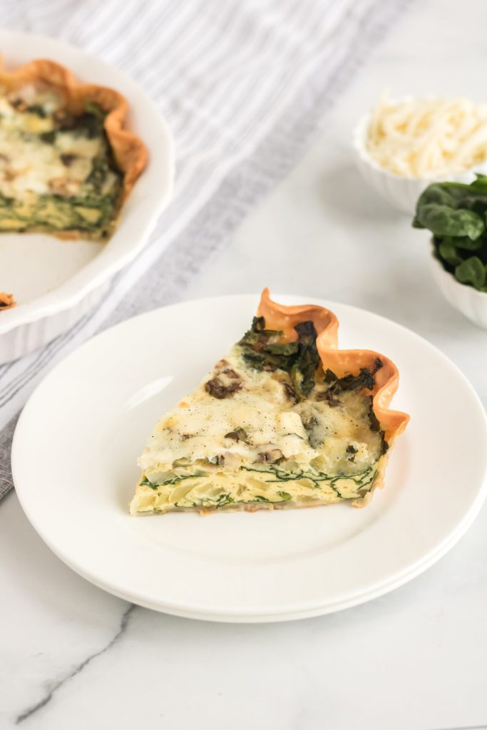 slice of Quiche Florentine on white plate