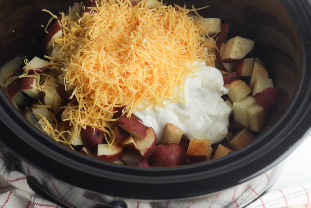 These quick and easy cheesy ranch potatoes are going to be your new family favorite! Grab your slow cooker and get ready for some cheesy deliciousness!