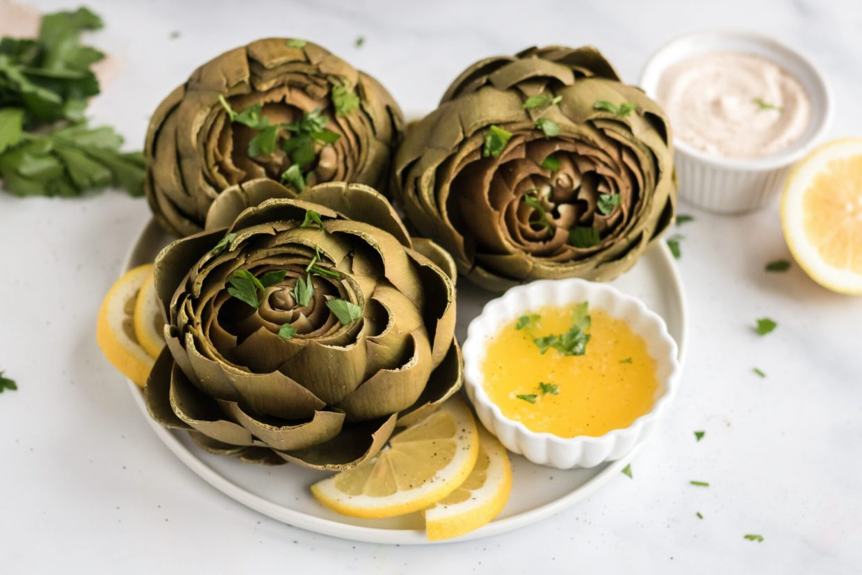 Melted Lemon Garlic Butter is the most versatile and delicious sauce you will ever make. Get ready to let your artichokes and other foods swim in this dipping sauce for artichokes!