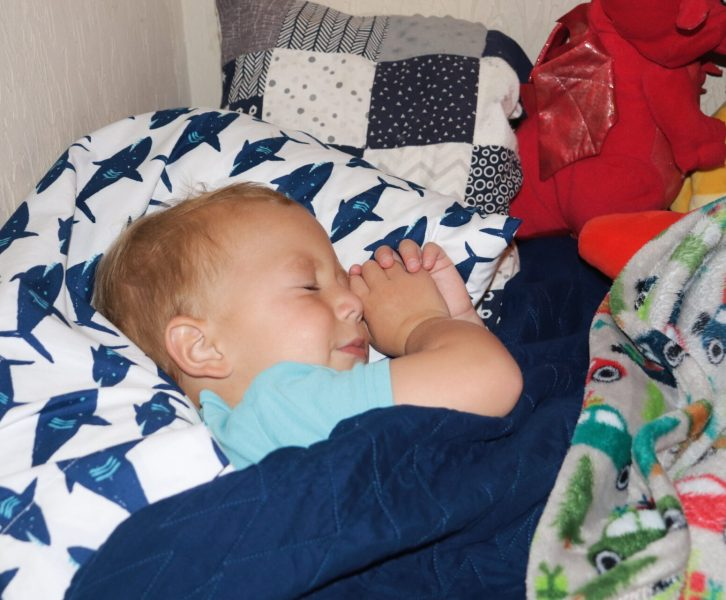 Setting up a 2 year old sleep schedule might feel stressful and overwhelming, even to a mom of 4 kids, but we are sharing 2 year old sleep training secrets to make sleep training your 2 year old a breeze, even with the transition out of a crib!