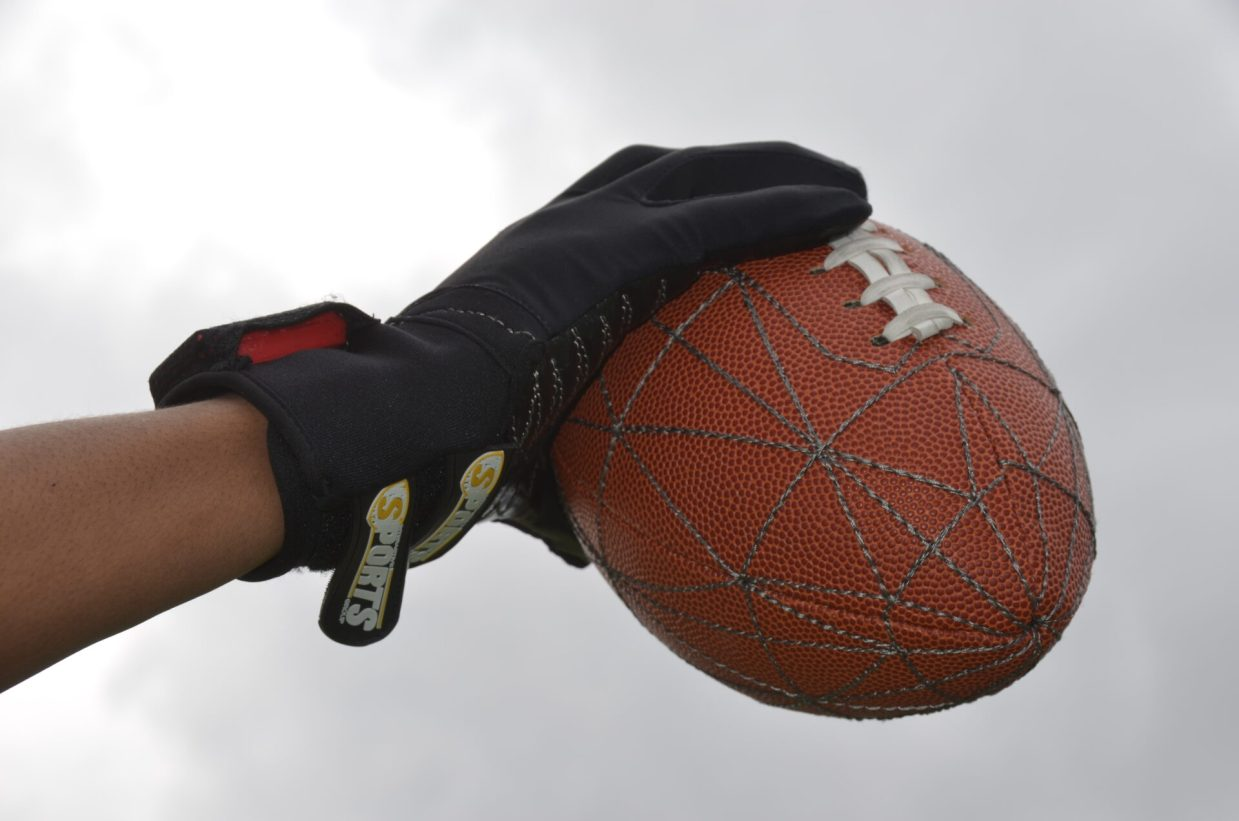 Football in hand as a great at home STEM activity