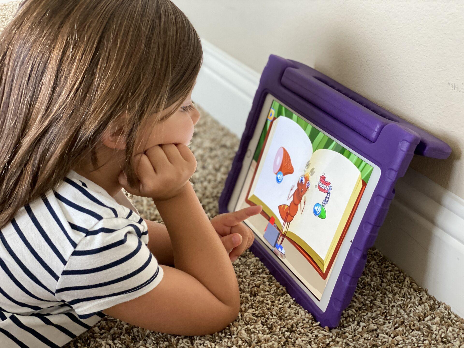 girl playing iPad on purple iPad
