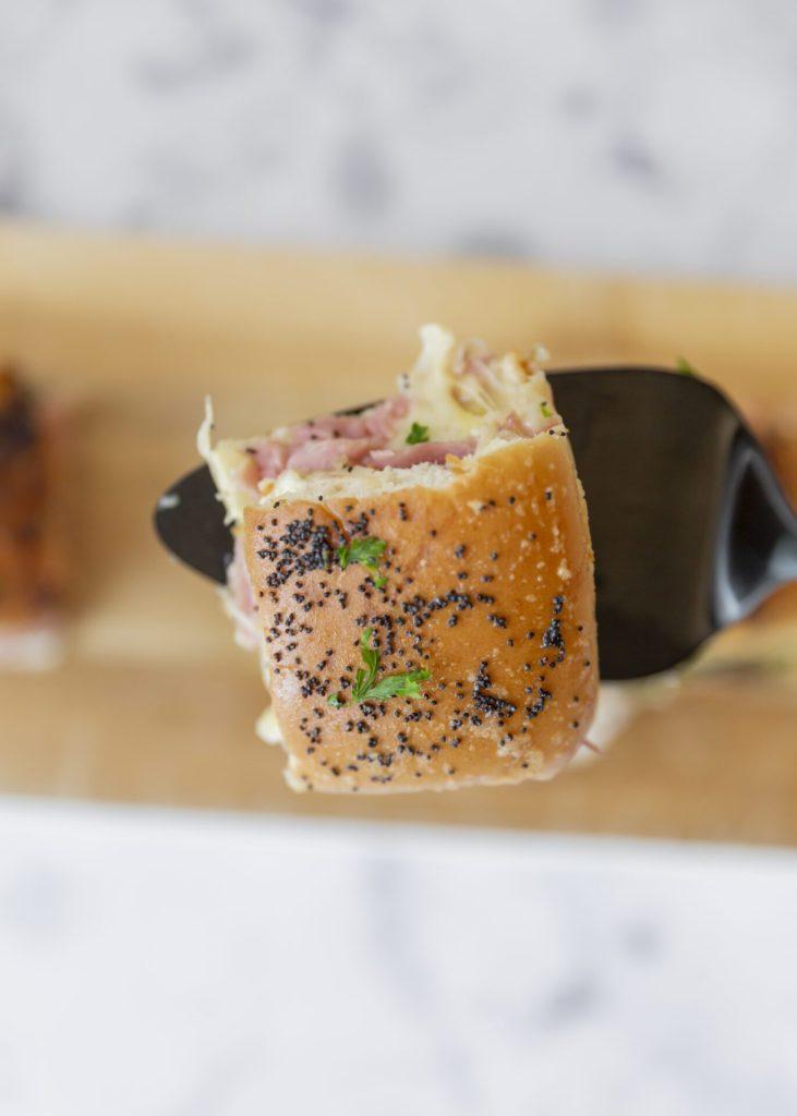 Ham and cheese slider on black utensil