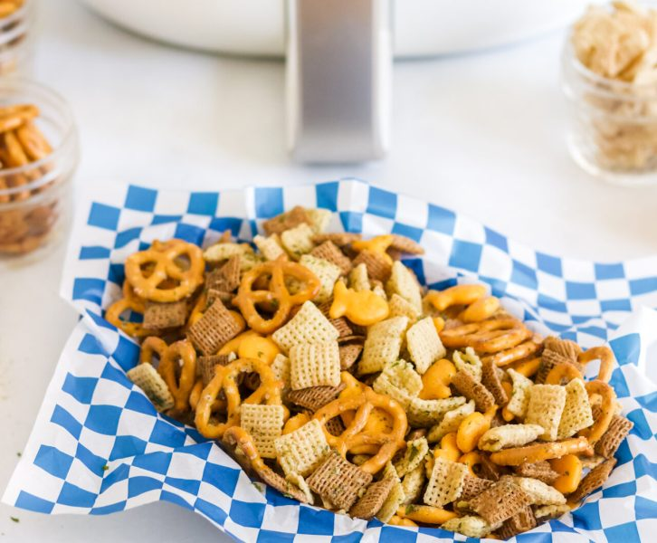 air fryer chex mix sitting with air fryer
