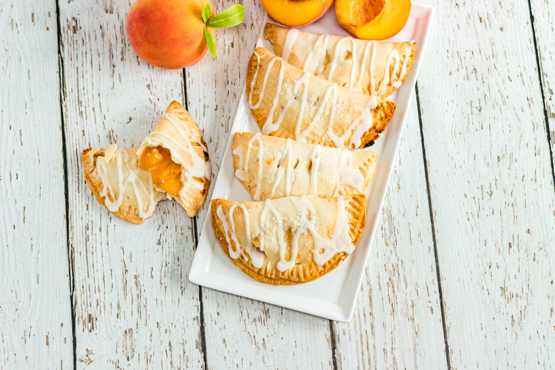 Air Fryer Peach Hand Pies on a white platter