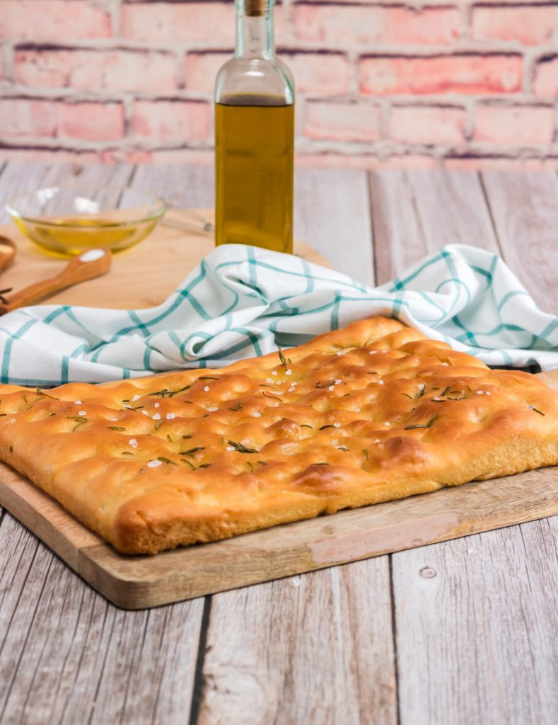 Cooked rosemary focaccia bread on counter