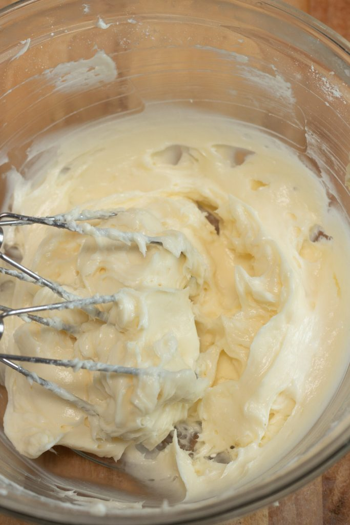 electric mixer mixing peaches and cream bars