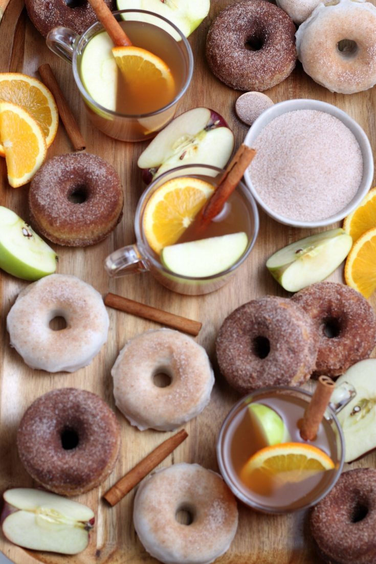 variety of donuts on cutting board