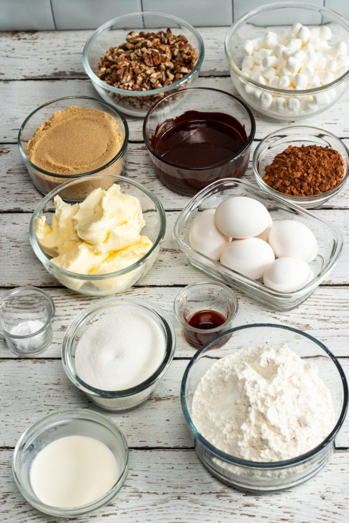 ingredients for mississippi mud cake in glass bowls and containers