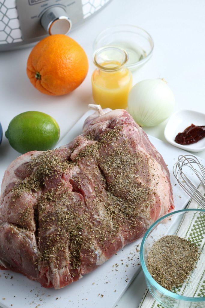 dry rub on pork roast sitting on a cutting board