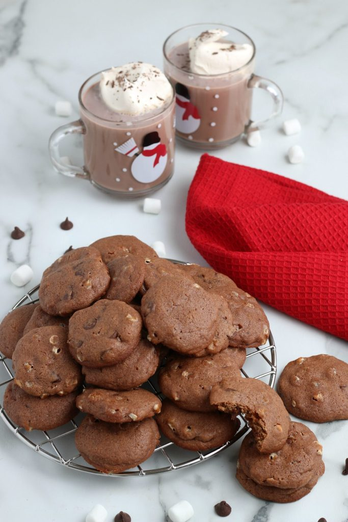 hot chocolate cookies with hot chocolate in snowman mugs