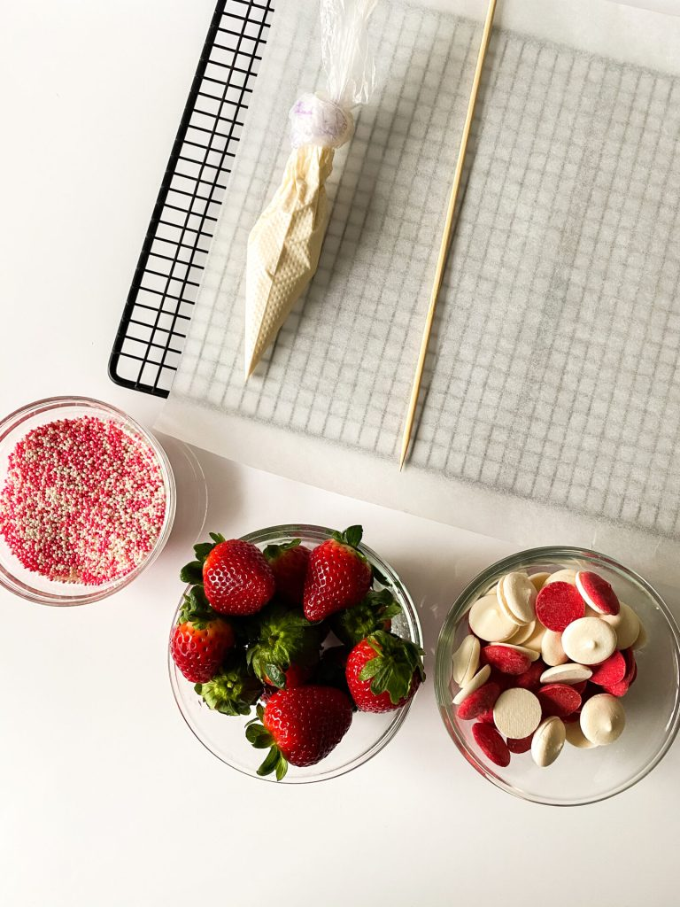 ingredients in glass bowls for valentines chocolate covered strawberries