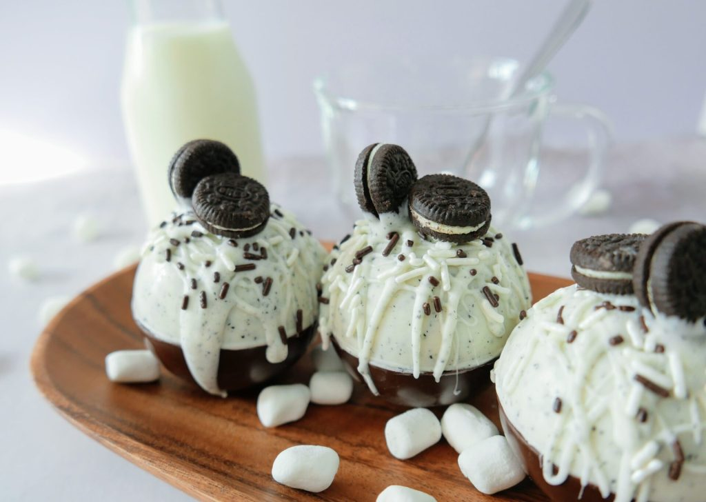oreo hot chocolate bombs with milk and glass bowl