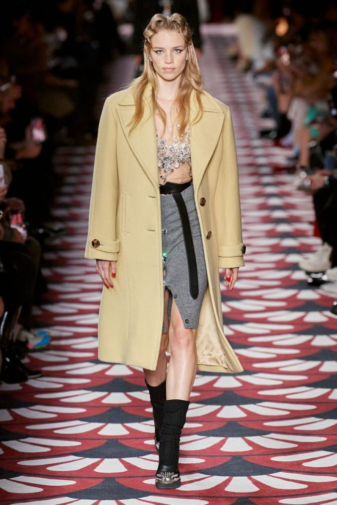 The most fashionable color is a bright yellow-green coat from the Miu Miu collection
