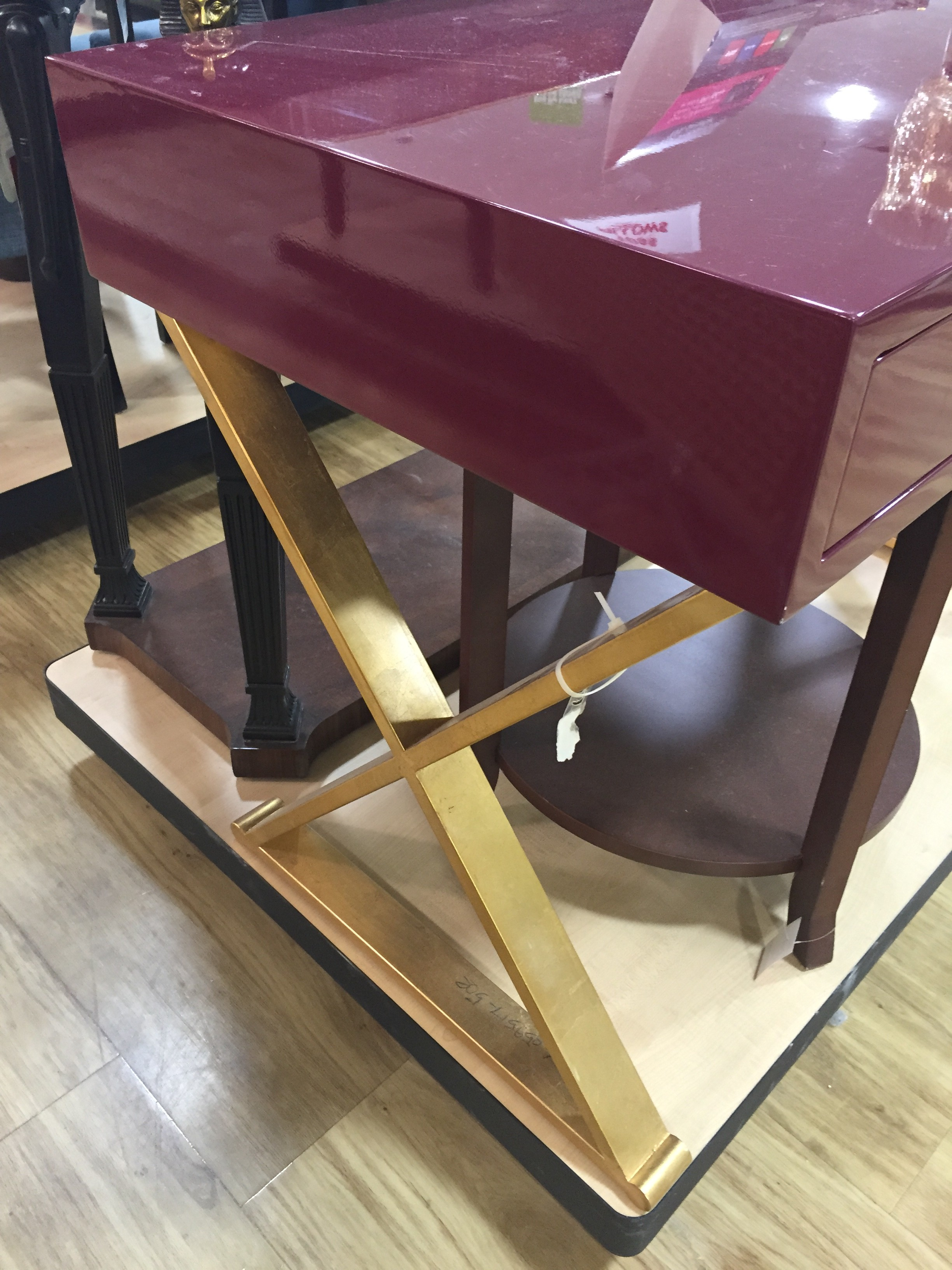 the color of the year marsala is well represented in homegoods and i spotted it in this sleek deskconsole table the gold xlegs and crystal knobs just