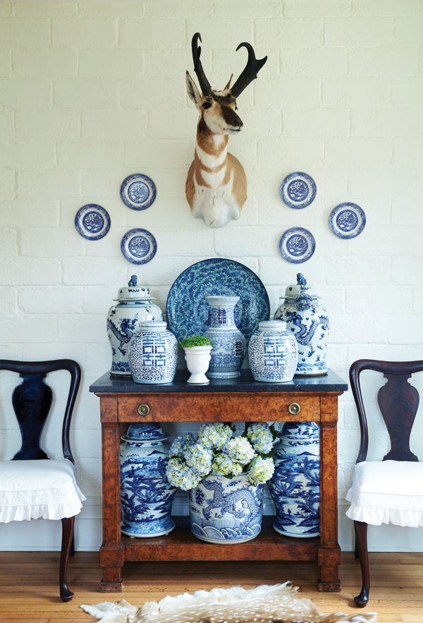 a collection can be used to decorate the top and underneath of a console table in a foyer or blue and white ginger jar