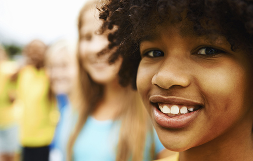 Closeup of an African American boy with his friends in background