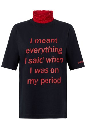Empowering black cotton feminist t-shirt with fun red printed slogan and red frill neck detail.