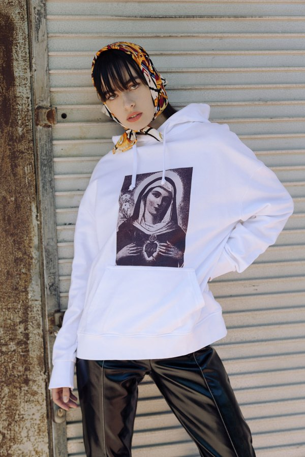 Ornate Silk scarf print scarf worn with white Virgin Mary printed hoodie. A celebration of love and humility.