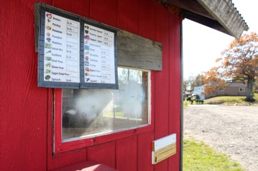 The New American Sustainable Agriculture Project's 30-acre farm takes up two sides of Littlefield Road in Lisbon, Maine. This farm stand is where the immigrants sell their crops.