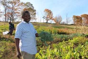 Omasombo with a handful of kale.
