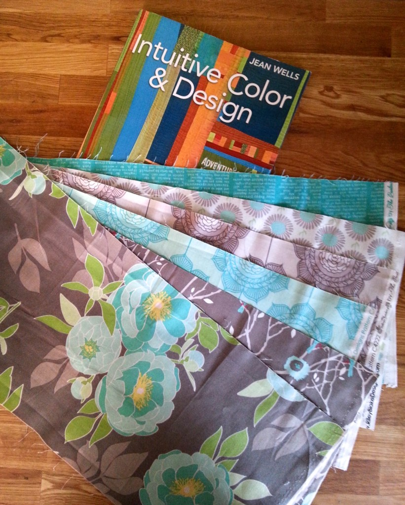 The inspiration pieces and the book I am using to guide me.  I like the color palette and am free to add more solids and patterns as long as they come from the same fabric line.