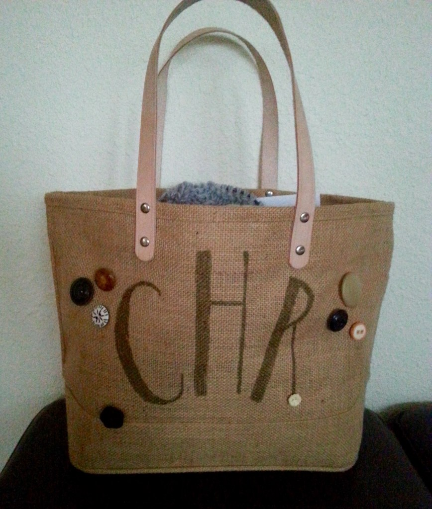 Spur of the moment creation.  We received the burlap tote as a welcome gift at a wedding we attended recently.  The blank canvas of it kept nagging at me so I decided to experiment.  One Sharpie and eight buttons later I had this.