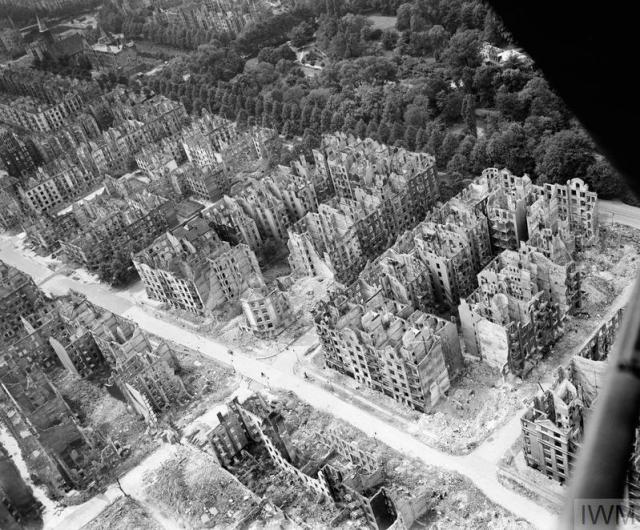 ROYAL AIR FORCE BOMBER COMMAND, 1942-1945. (CL 3400) Oblique aerial view of ruined residential and commercial buildings south of the Stadtpark (seen at upper right) in the Eilbek district of Hamburg, Germany. These were among the 16,000 multi-storeyed apartment buildings destroyed by the firestorm which developed during the raid by Bomber Command on the night of 27/28 July 1943 (Operation GOMORRAH). The road running diagonally from upper left to low... Copyright: © IWM. Original Source: http://www.iwm.org.uk/collections/item/object/205023601