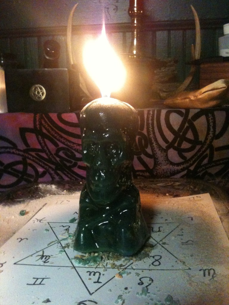 Skull candles, financial wisdom spell at Conjure Work