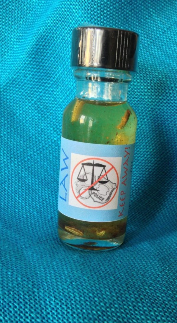Law Keep Away Oil, made by Magus at Conjure Work, sorcery supplies and services